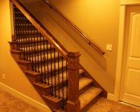 Red oak staircase with box newel and iron balusters