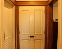 Pre-hung interior door with stain-grade craftsman style oak trim