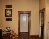 Knotty alder entry door with red oak box newel
