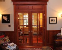 10 lite double door in maple with cherry finish with custom raised panel transom