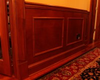 Custom maple wainscoting, chair rail, and maple casing with plinth block
