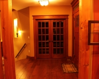 French double doors with red oak casing and header
