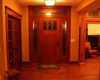 Entry door with red oak trim and header