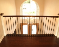 Custom maple newel posts and iron balusters